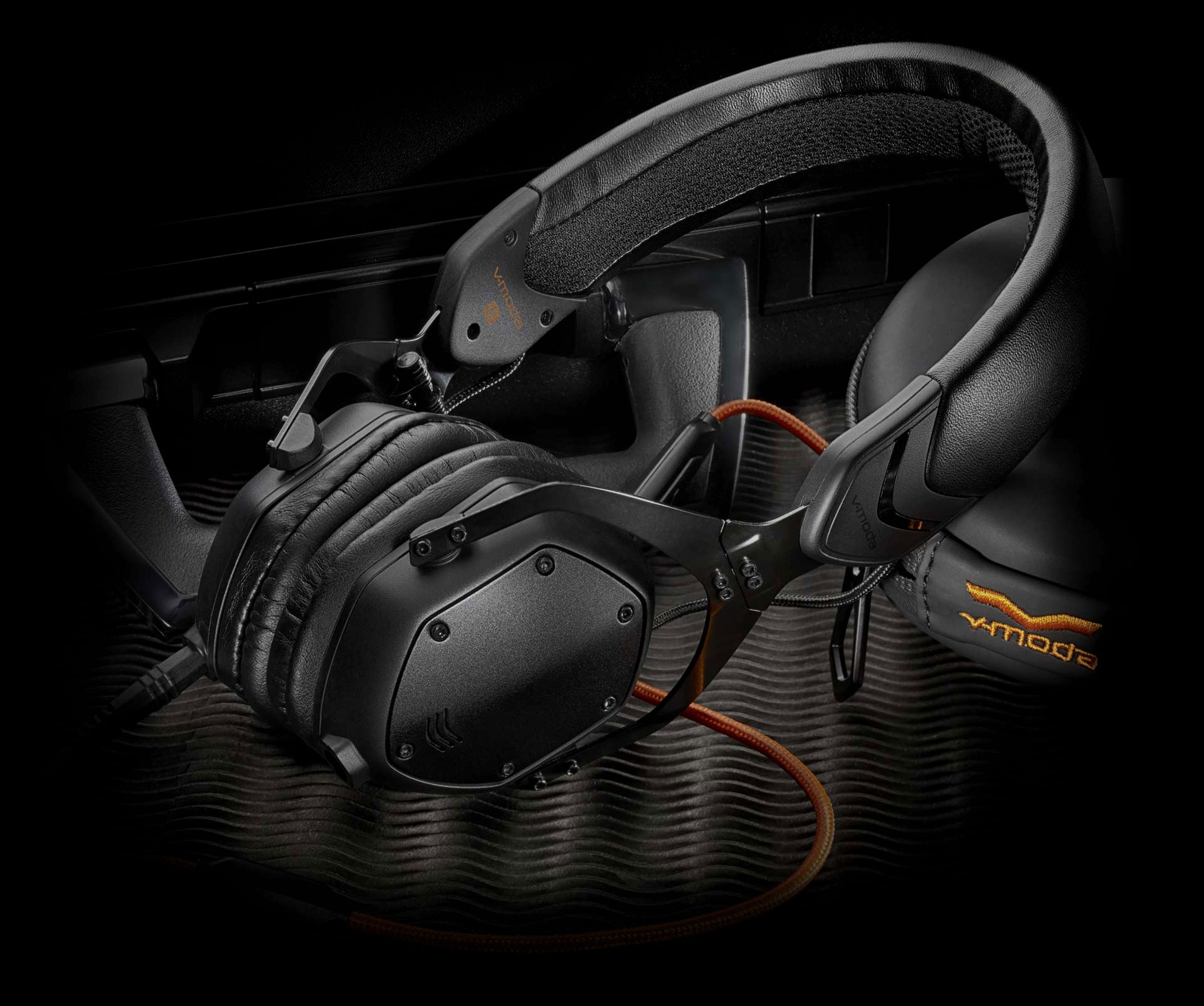 Black XS On-Ear Headphones with its protective travel carry case